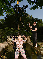 Tattooed Blonde Tethered To A Frame