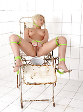 Sexy blonde Lana pisses in bowl
