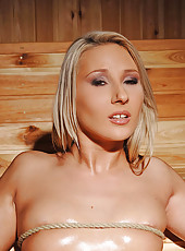 Blonde cutie bound in the sauna!