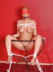 Hot bound babe Daria Glower peeing