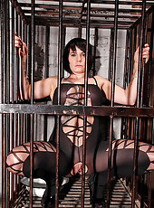 Busty bound hot babe pisses in cage
