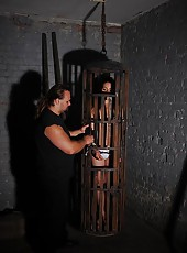 Bound naked Bianka spanked in cage