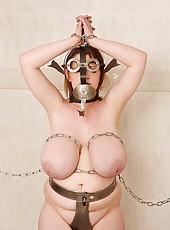 Tempting busty bound babe Eva naked