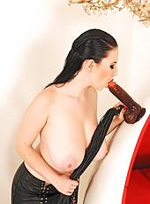 Busty Karina Heart posing in latex