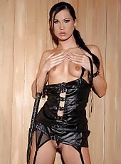 Sonja Black masturbating in latex
