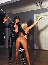 Kinky lesbians spanking in latex