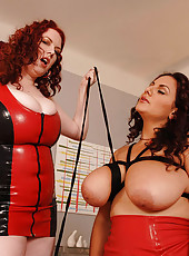Busty latex lesbos having kinky fun