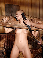 Sexy restrained babe in the barn