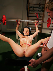Aletta is bound to a weights bench