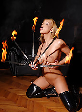 See Dorothy fire juggling in latex