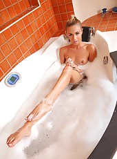 Pretty Blonde Footjobs in the Tub