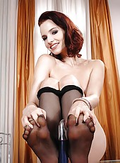 Redhead Leila Smith on glass table