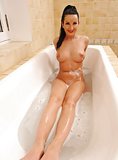 Fitness cutie plays in the bathtub