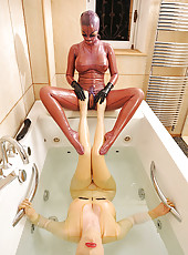 Latex beauties enjoying the tub!