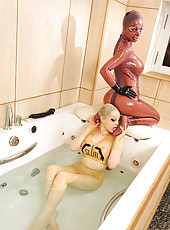 Latex beauties enjoying the tub!