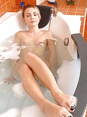 Nataly washes cock with her feet!