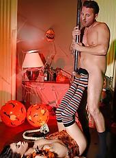 Halloween stripper gives footjob!