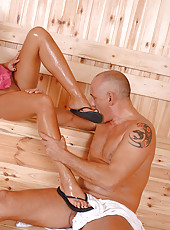 She strokes his cock with her feet!