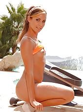Sporty sexpot strips near the pool!