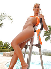 Sporty sexpot strips near the pool!