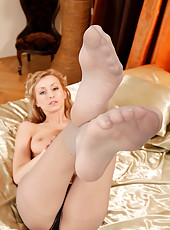 Blonde Coxy taking off pantyhose