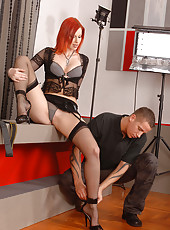 Redhead lets guy worship her legs!