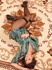 Eve Angel posing naked on carpet