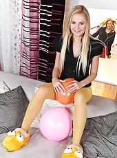 Blonde teen Claudie posing her legs