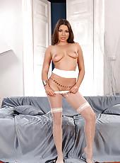 Brunette Zafira posing in pantyhose