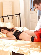 Stracy gives a footjob in stockings