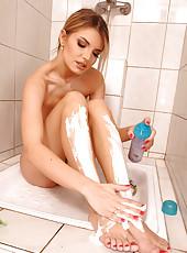 Blonde Suzie shaving in the shower
