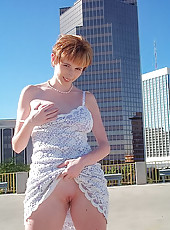 Redhead Elli flashing the offices in Tucson!