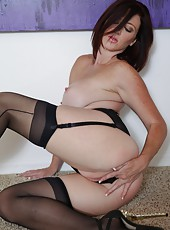 Gia Seduces You In Stockings & Heels
