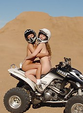 Two Young Chicks Riding Nude In The Desert!