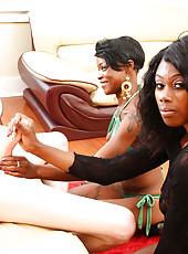 Two ebony slut jerks off big throbbing dick