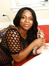 Young ebony babe  Hazel Paradise giving a sensual handjob