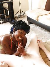 Busty ebony slut Queenie jacking big cock and get huge cumshot